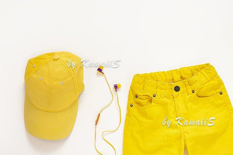 Yellow flat lay jeans, baseball cap, headphones,casual style example image 1
