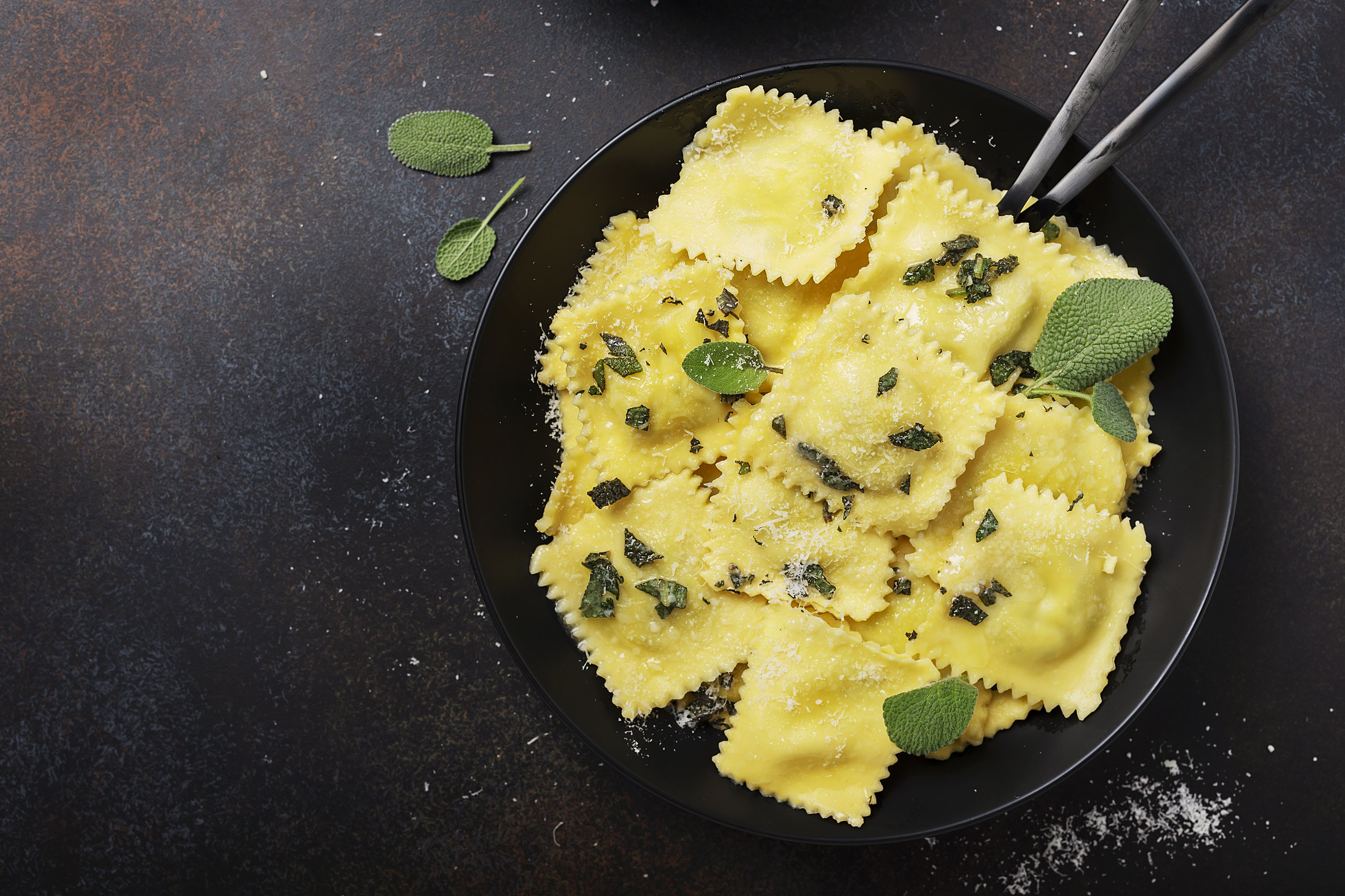 Top down view of a traditional Italian ravioli with butter example image 1