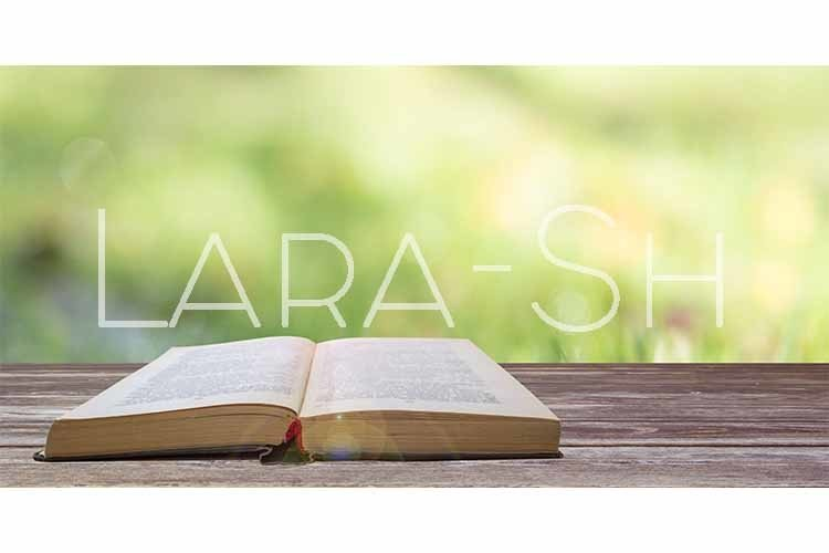 Open book on wooden table on green natural background example image 1