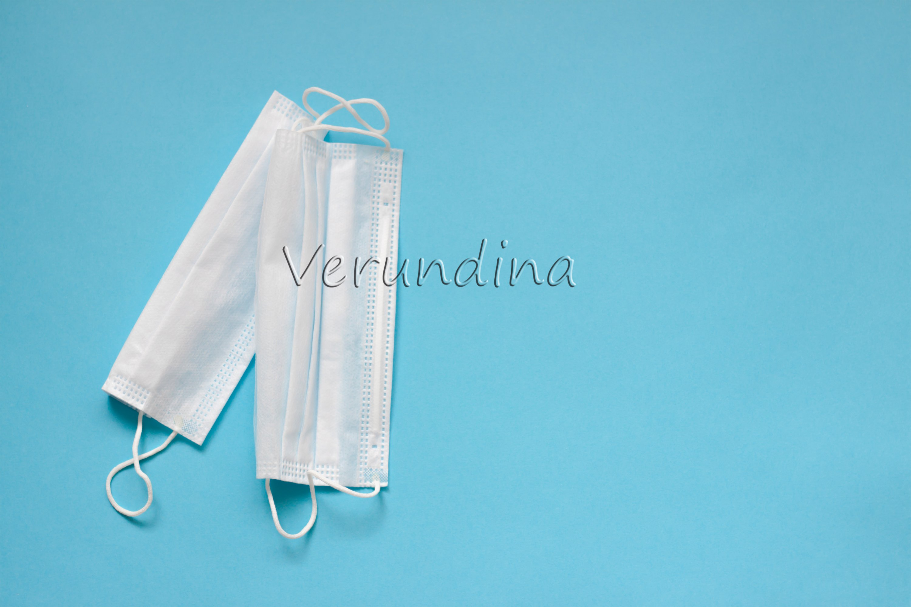Face masks, thermometer on on a blue background example image 2
