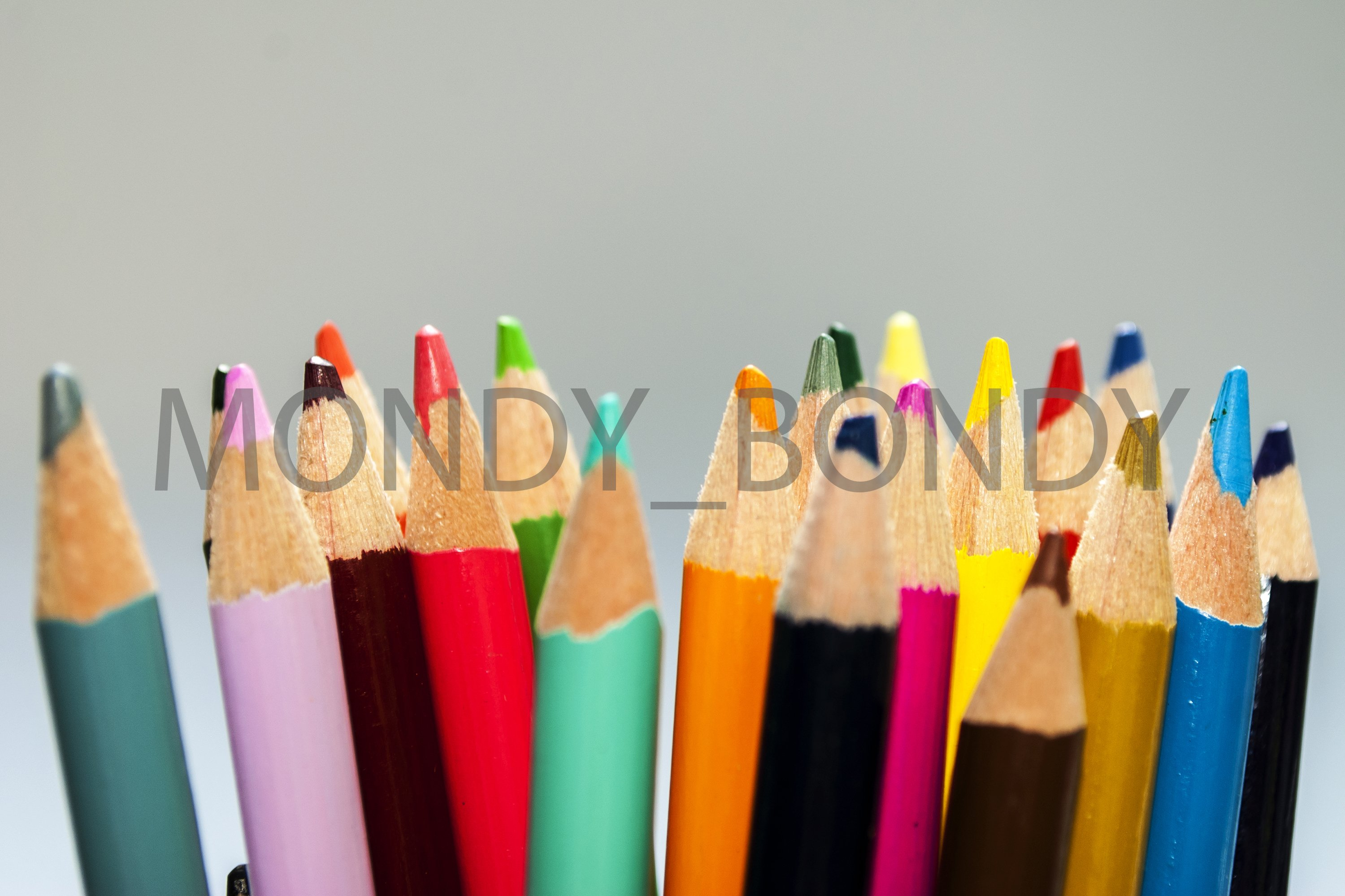 Color pencils on a white background close-up example image 1