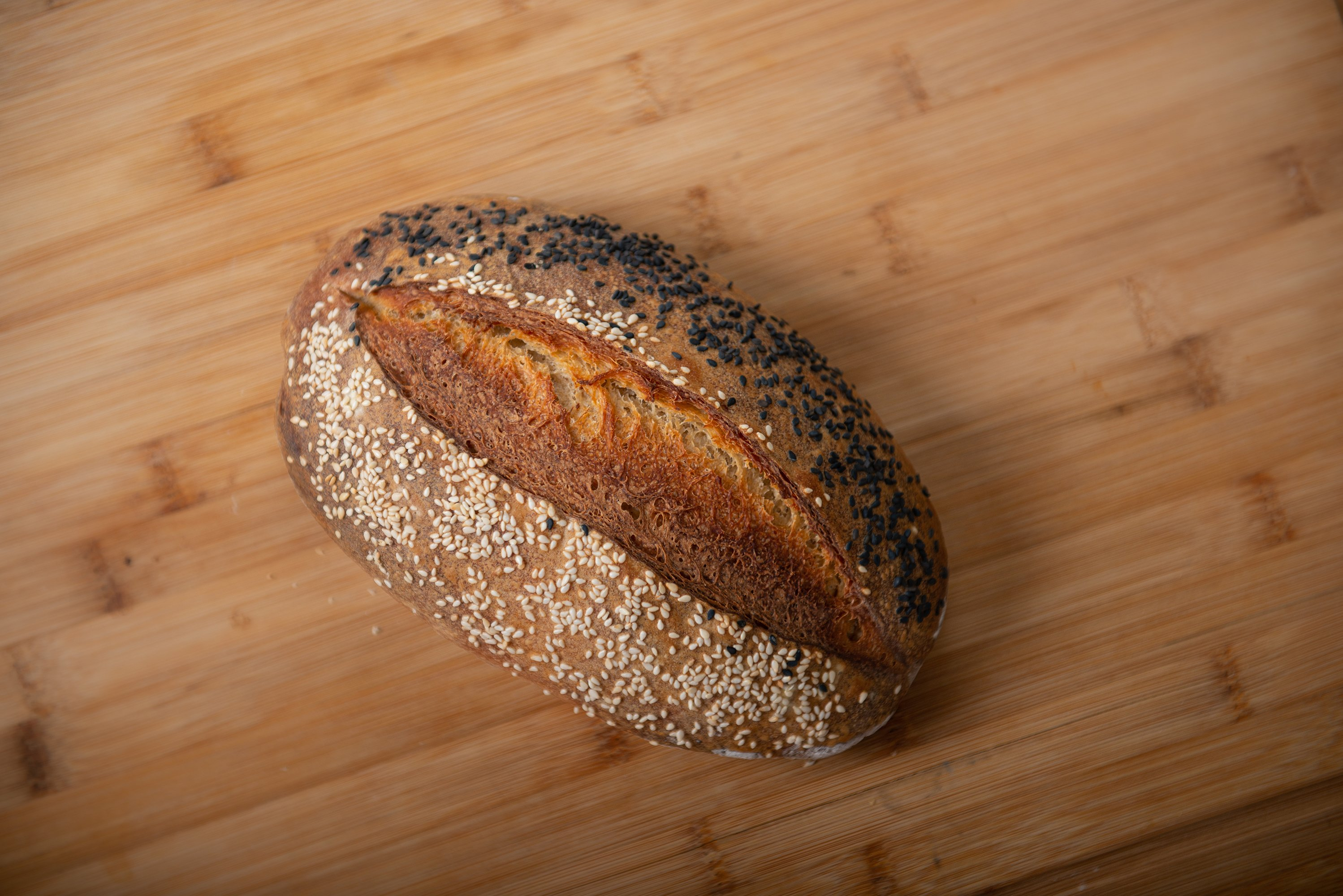 craft bread is sprinkled with white and black sesame seeds example image 1