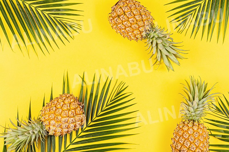 Pineapples and tropical palm leaves on yellow background example image 1
