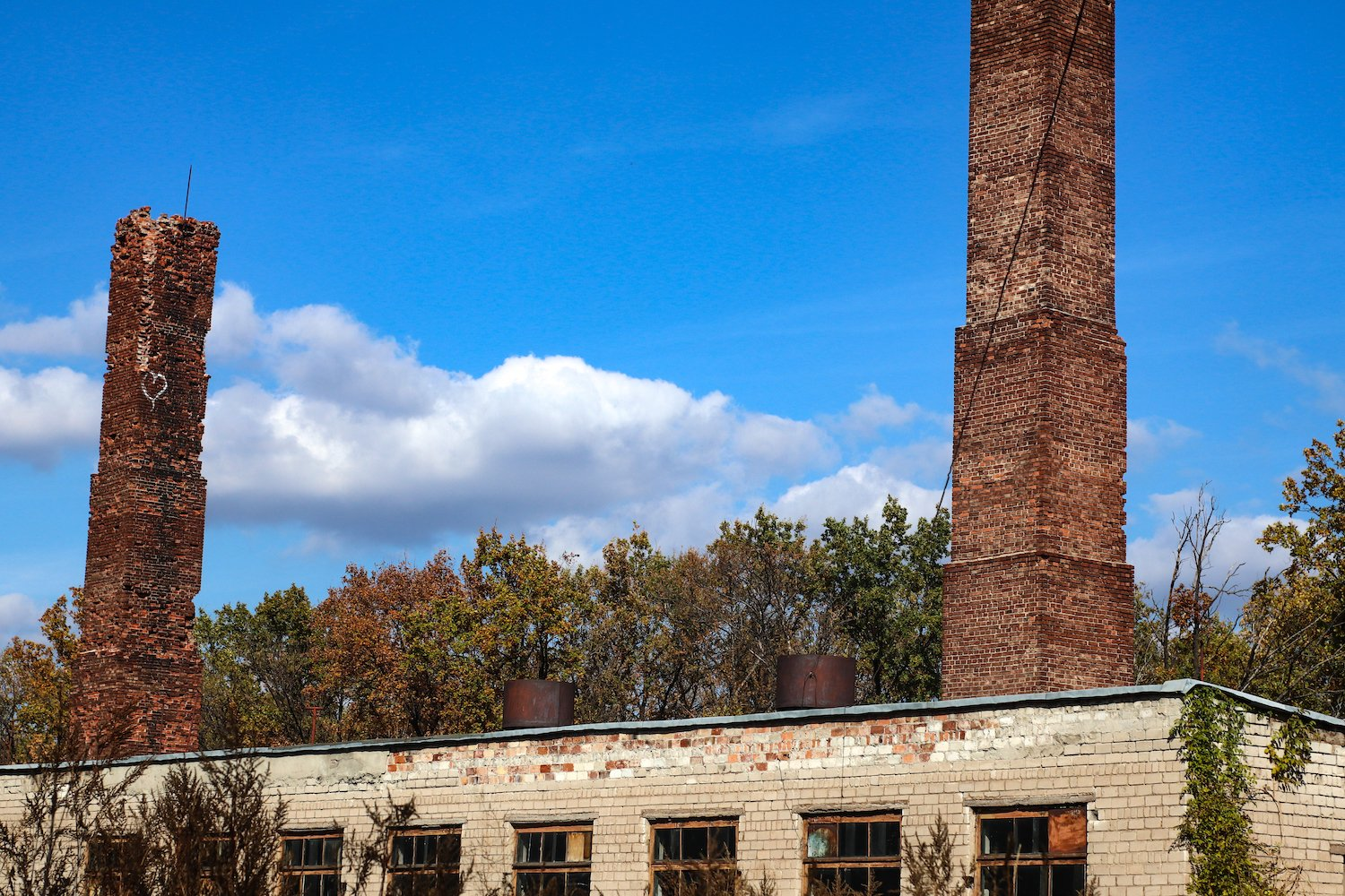 old brick building with two pipes example image 1
