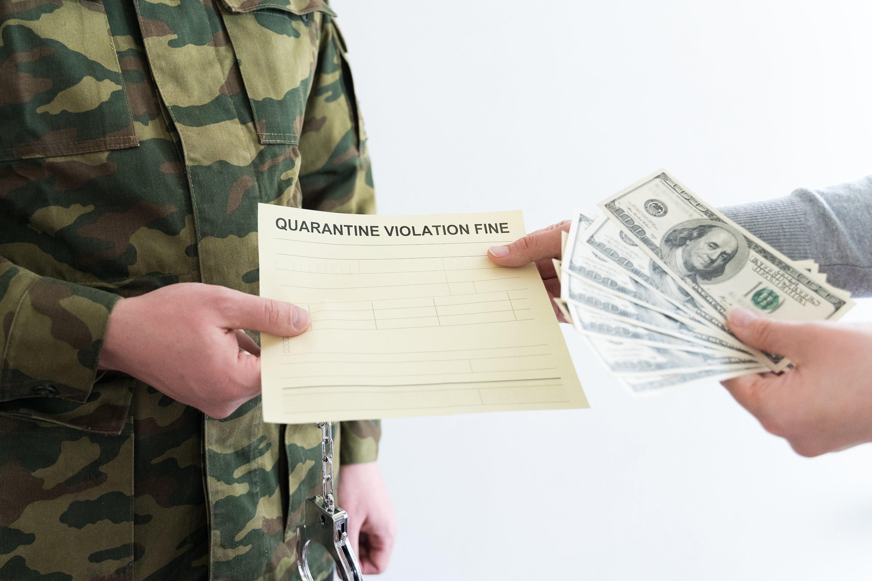 Police officer with self-isolation violation fine. Pay money example image 1