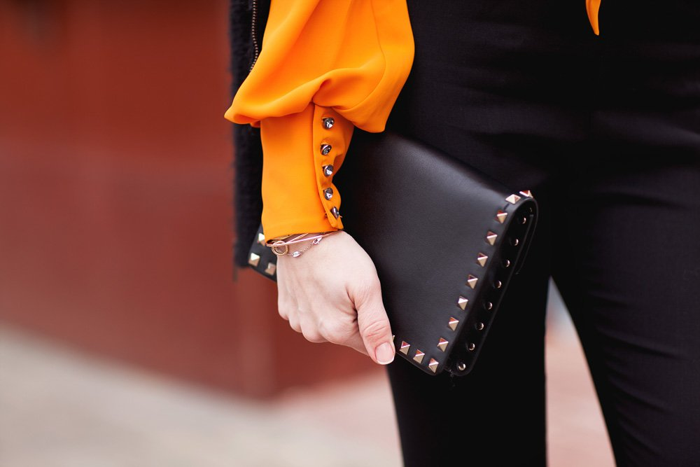 Clothing details, black jacket, black pants, orange blouse example image 1