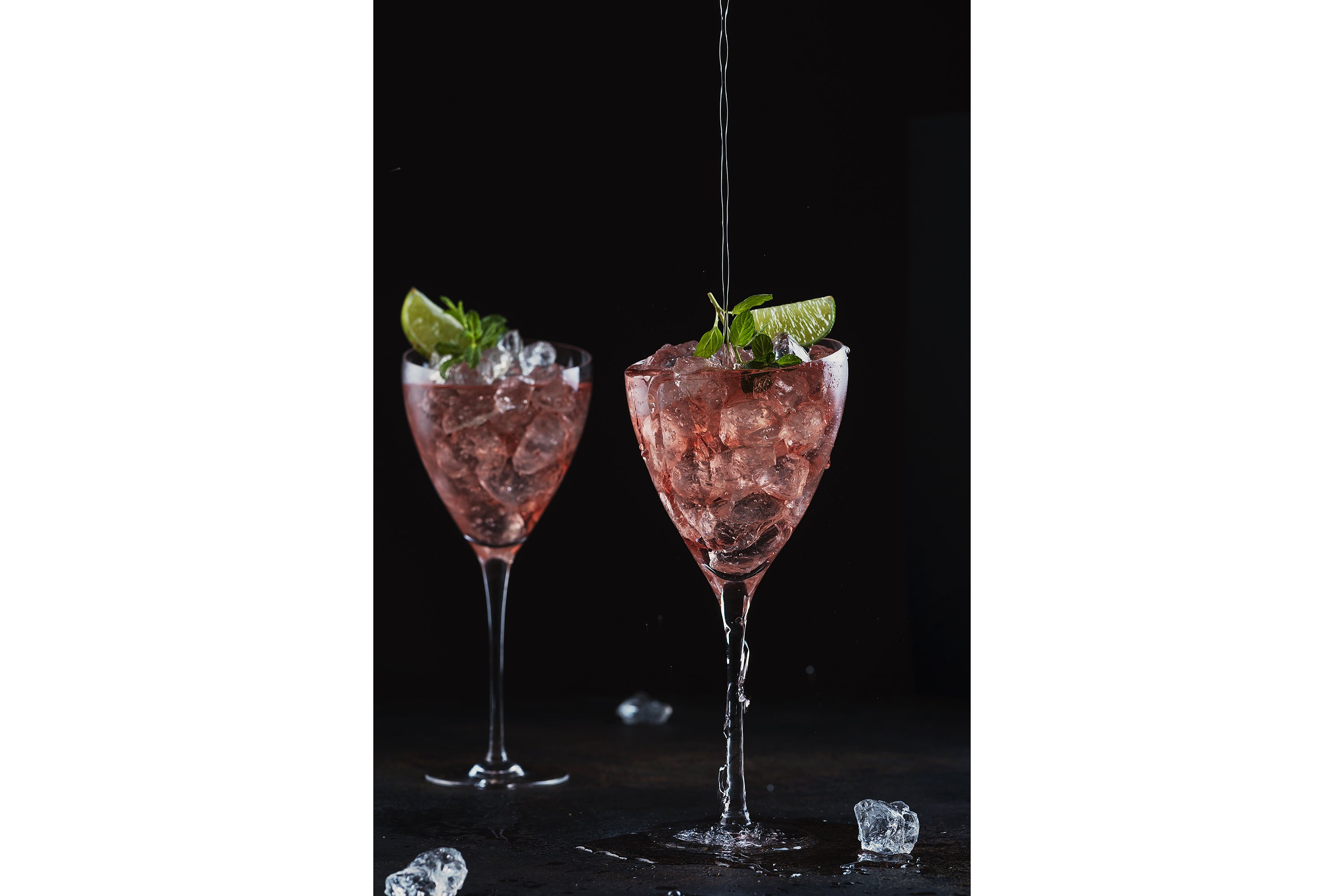 Summer cocktail with rose wine, lime, mint and ice example image 1