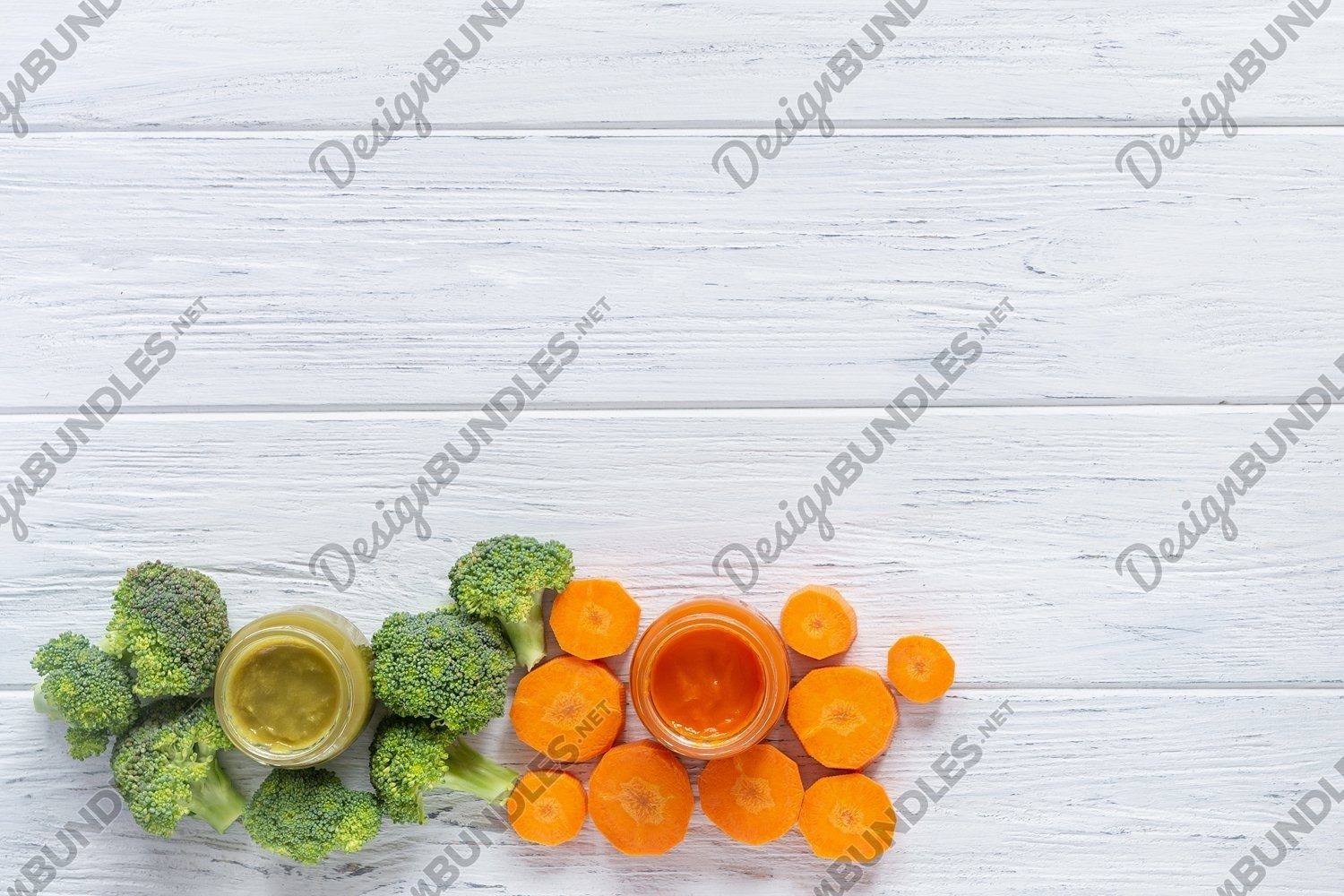 Glass jars with baby food on white wooden background example image 1