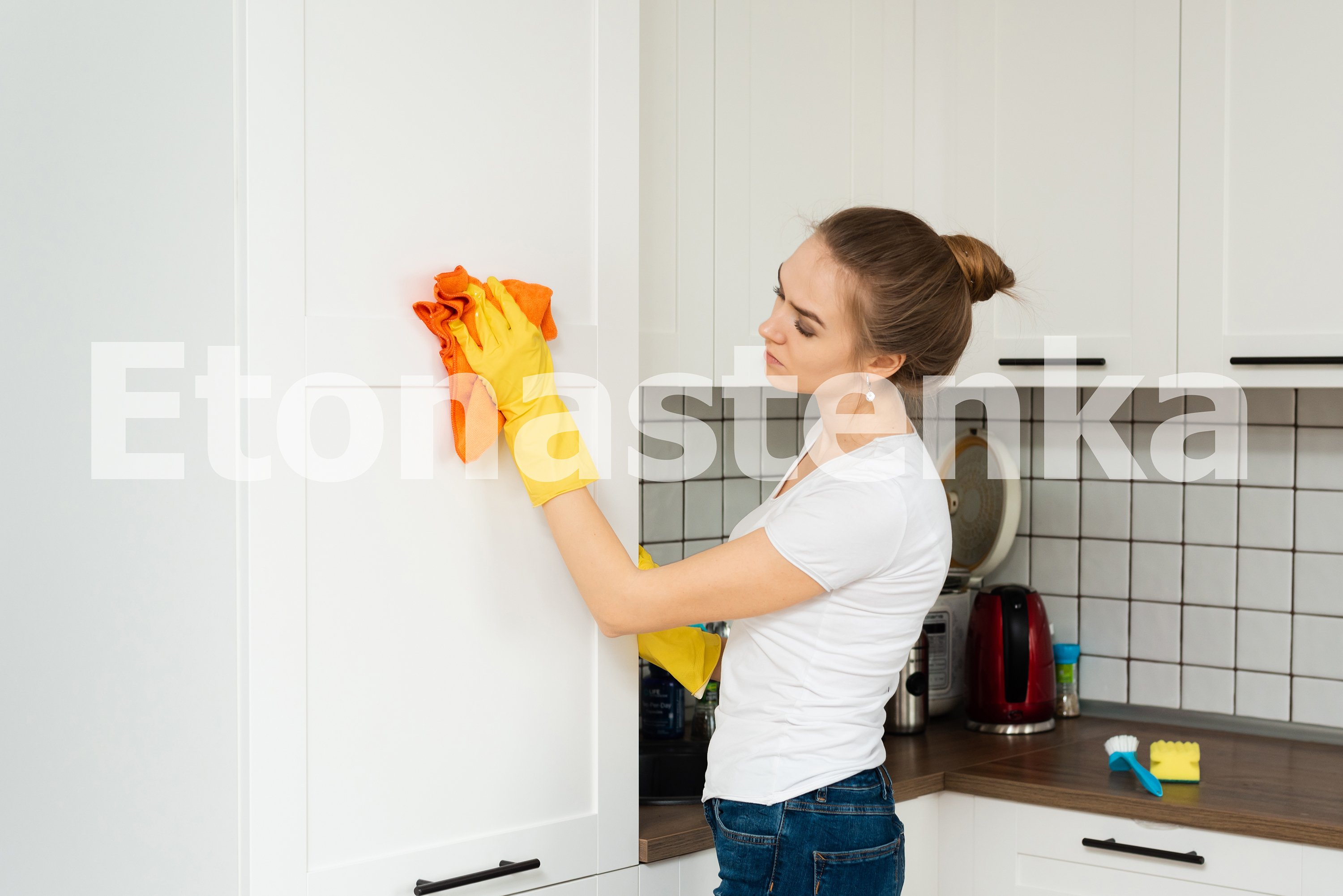 Spring cleaning. A young girl is cleaning her house. example image 3