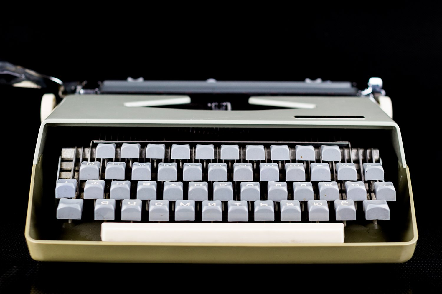 Typewriter on the table on a black background example image 1