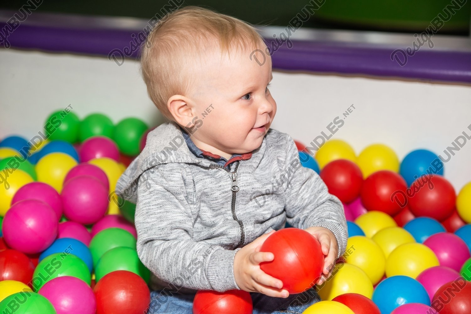 Photo of a ball pit poll at kids play center example image 1