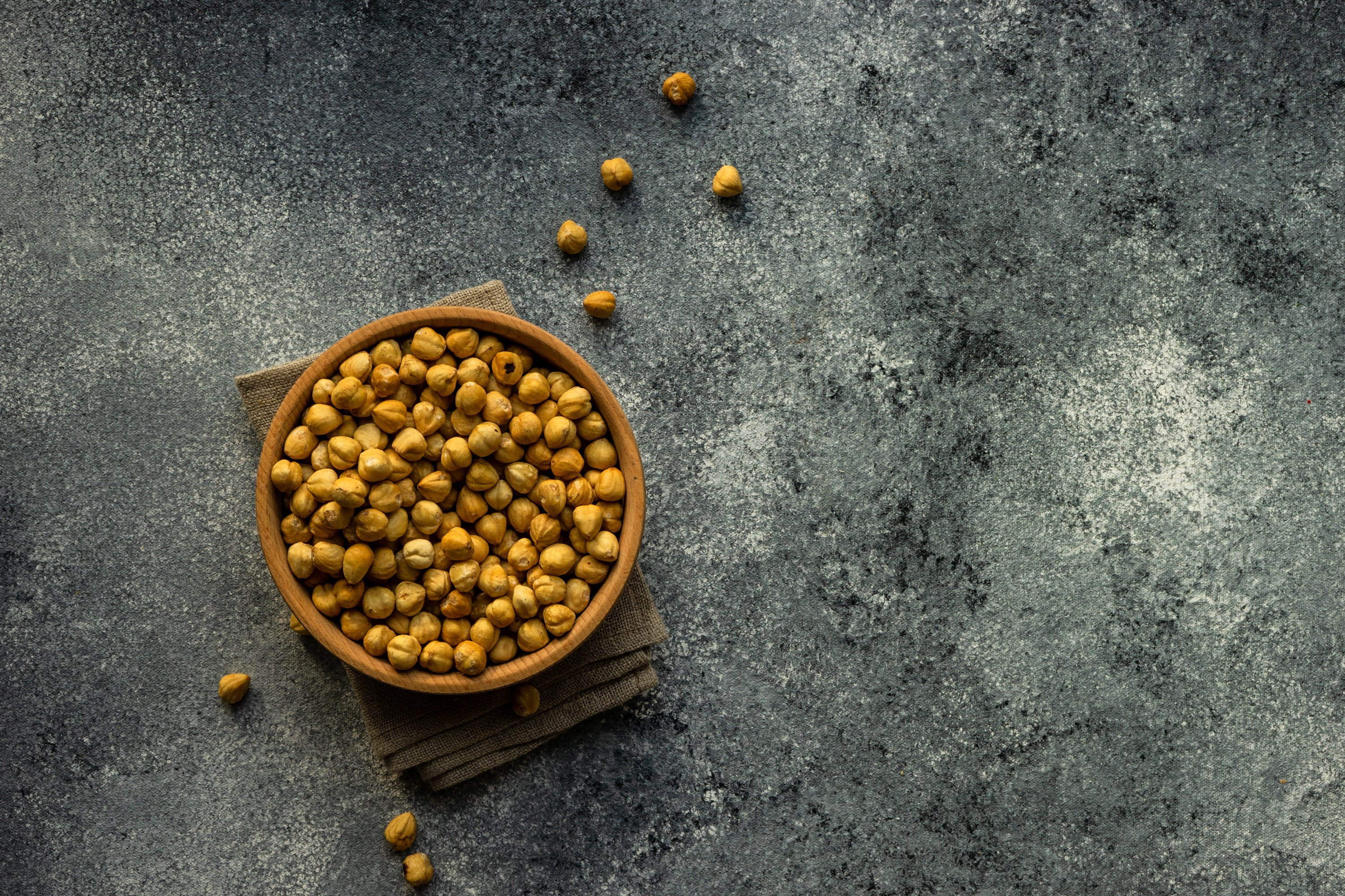 Different types of hazelnuts on dark wooden background example image 1