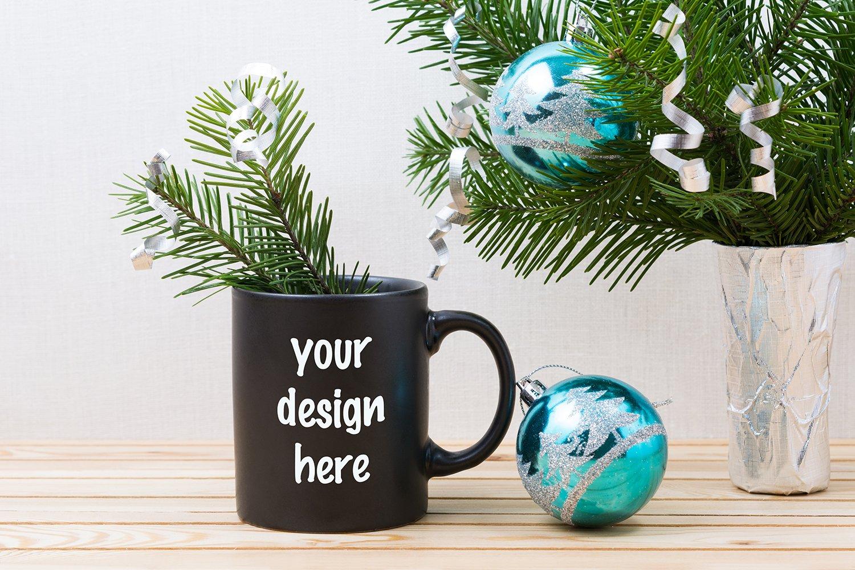 Black coffee mug mockup with blue Christmas ornaments example image 1
