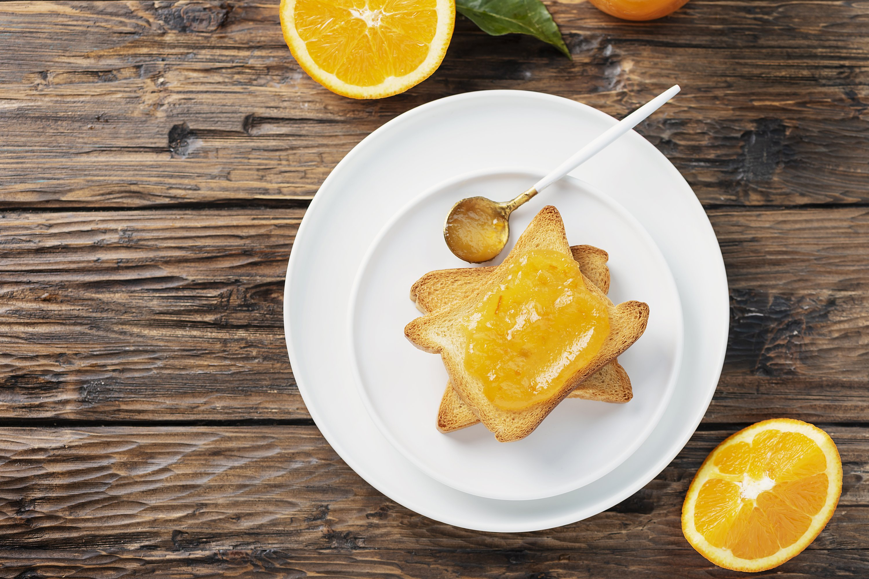 Traditional italian breakfast with Toast bread and oranges example image 1