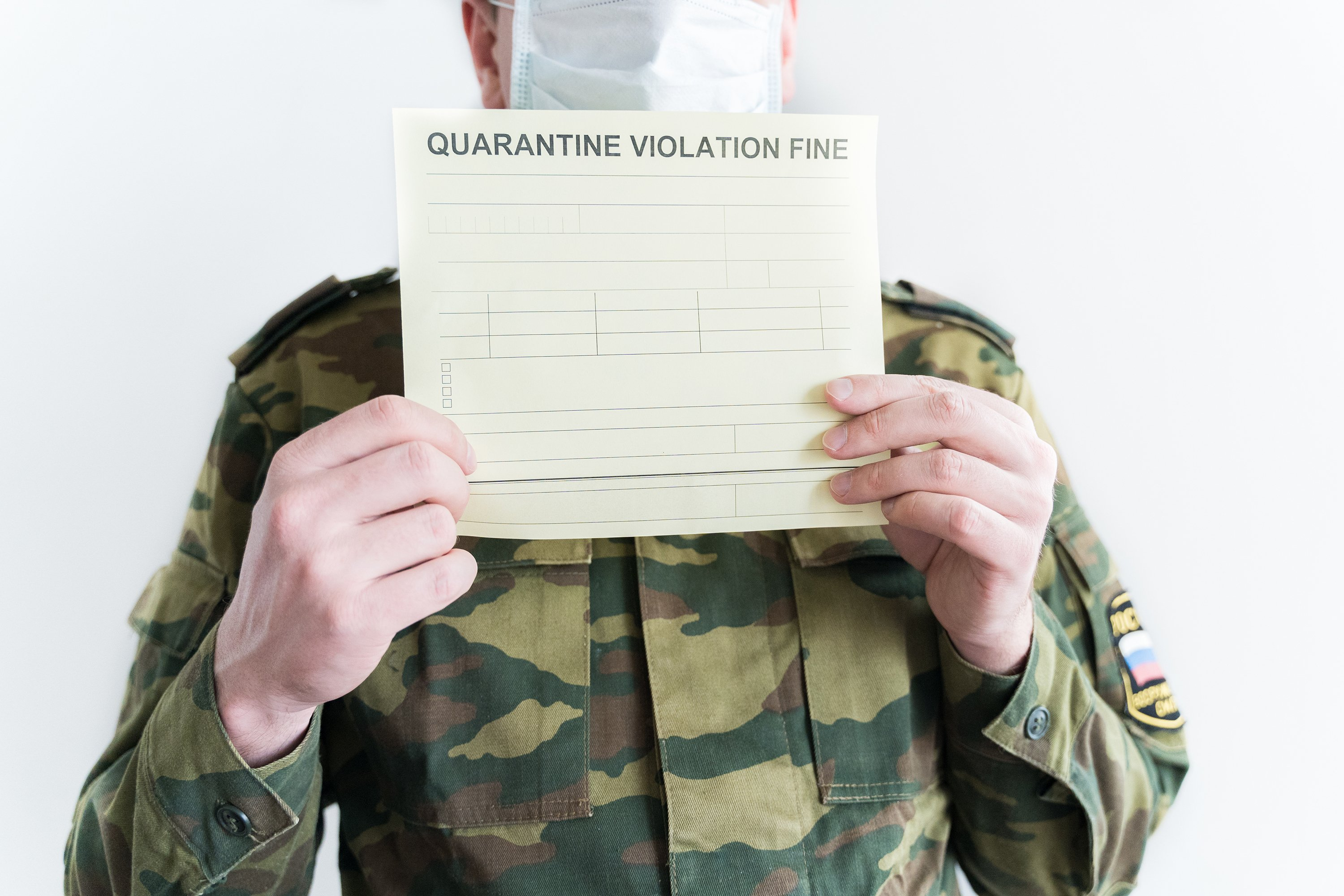 Police officer with self-isolation violation fine. Face mask example image 1