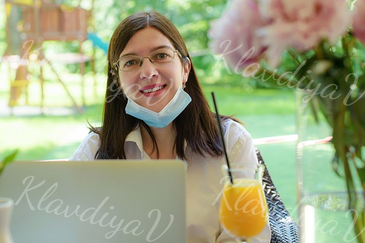 works at a laptop on the summer veranda example image 1