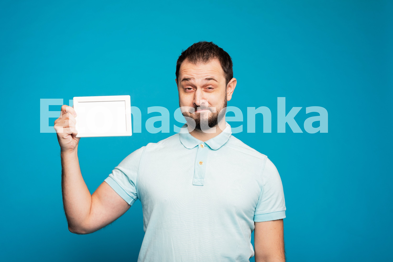 Happy millennial Caucasian guy on blue studio example image 1