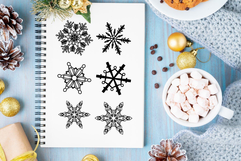 Flakes - A Dingbat Snowflake Font example image 2