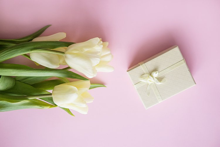 Yellow Tulip flowers are arranged on a pink background. example image 1