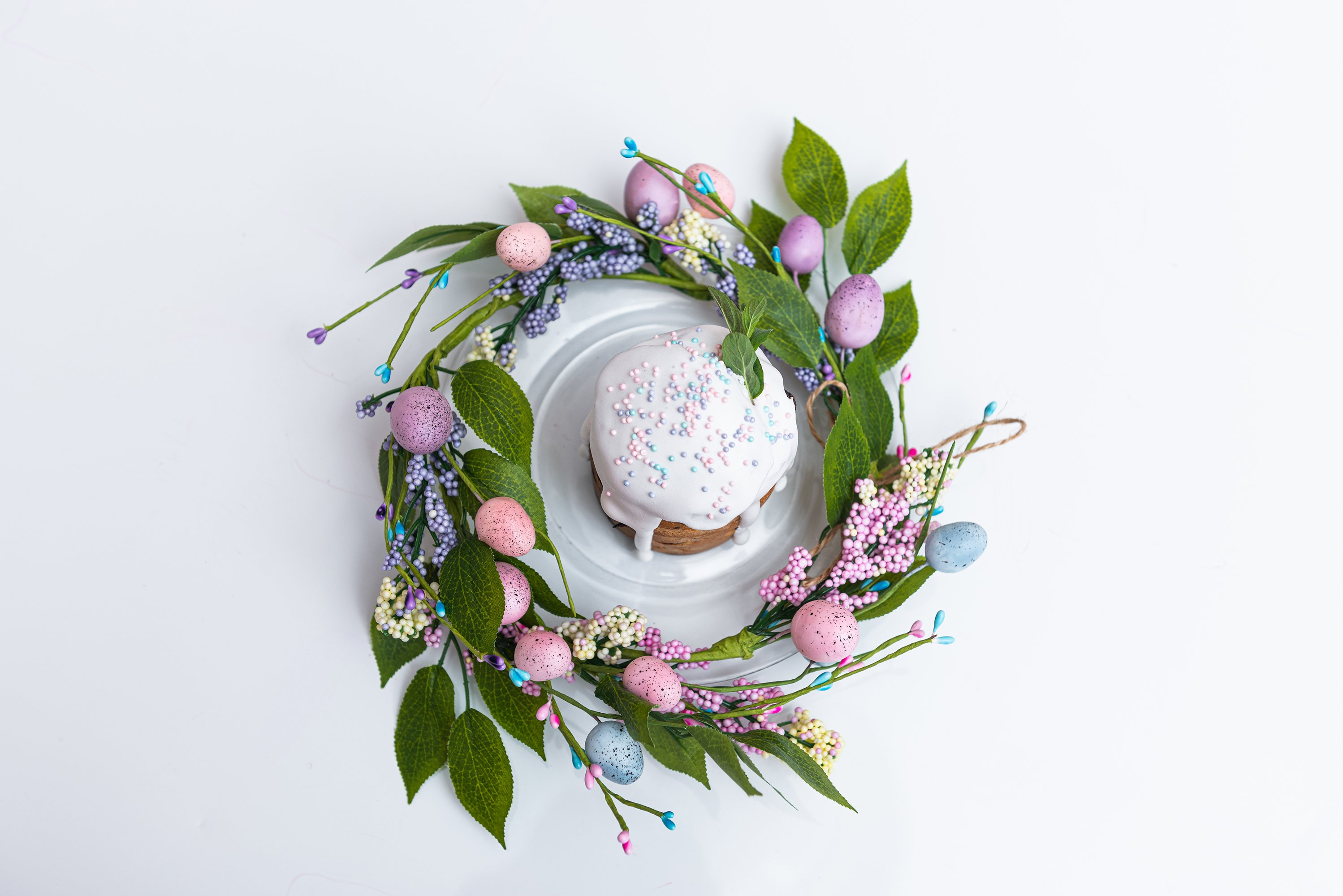 Easter cake in the center of a wreath of spring flowers example image 1