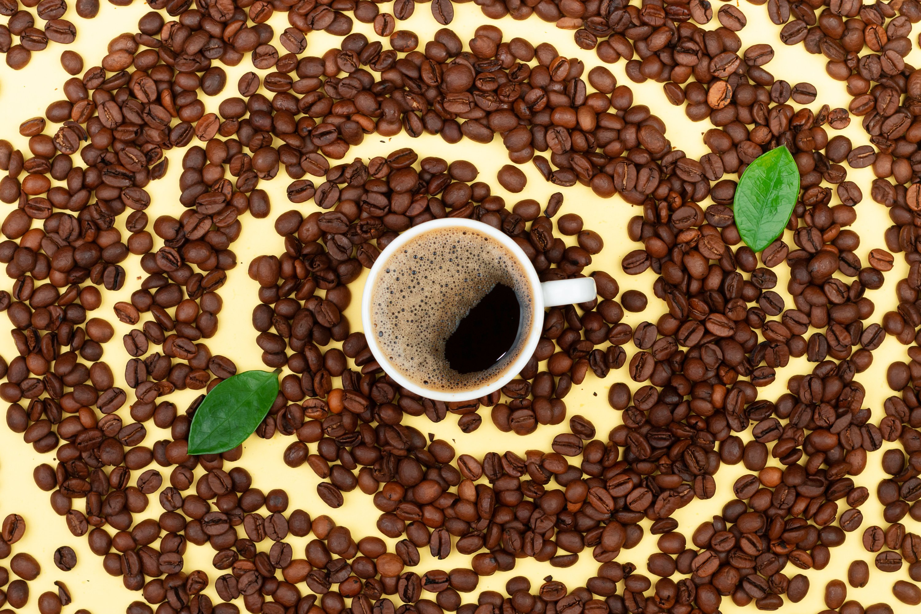 Fresh coffee and coffee beans on the table example image 1