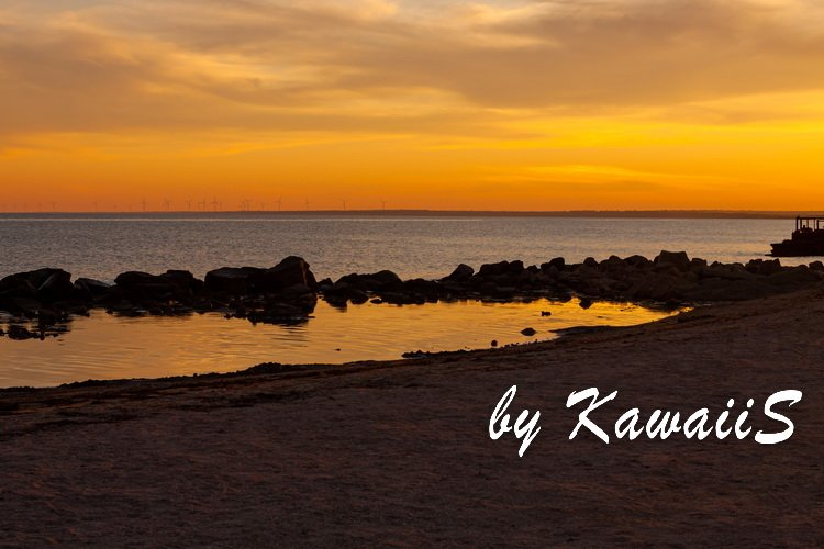 Colorful sunset on empty sea beach with sport catamarans example image 5