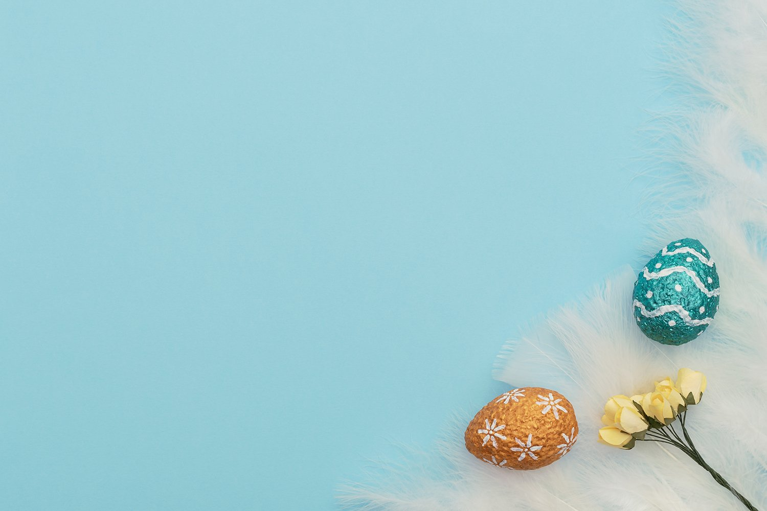 Easter eggs with yellow spring flowers example image 1