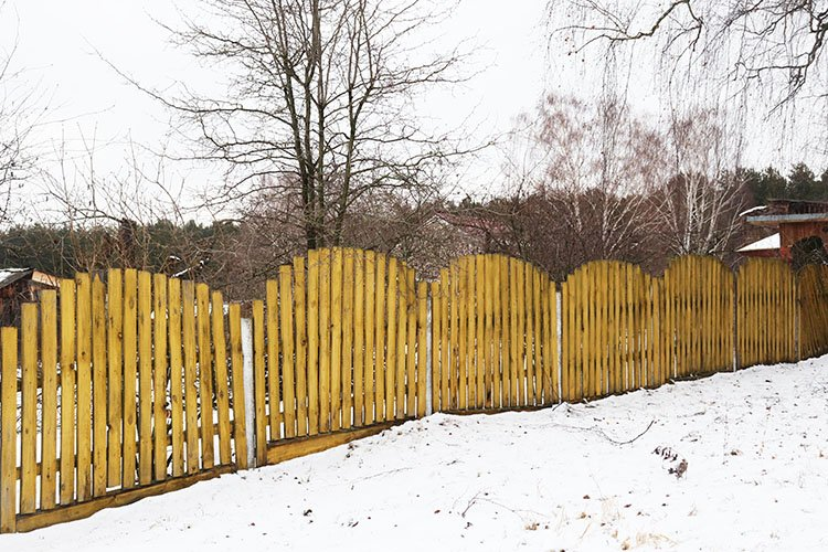 yellow wooden fence in the village example image 1
