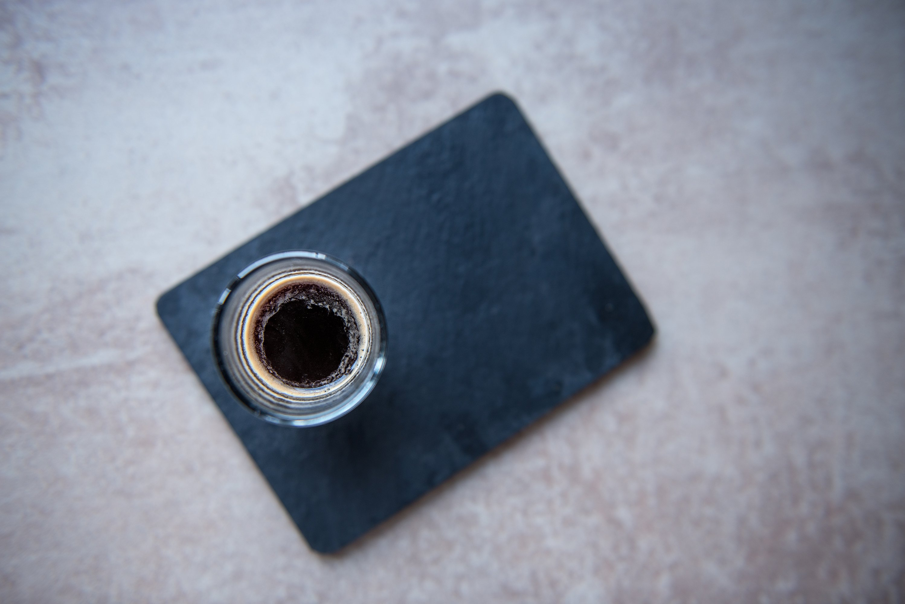 Top view on glass cup of espresso on black board example image 1