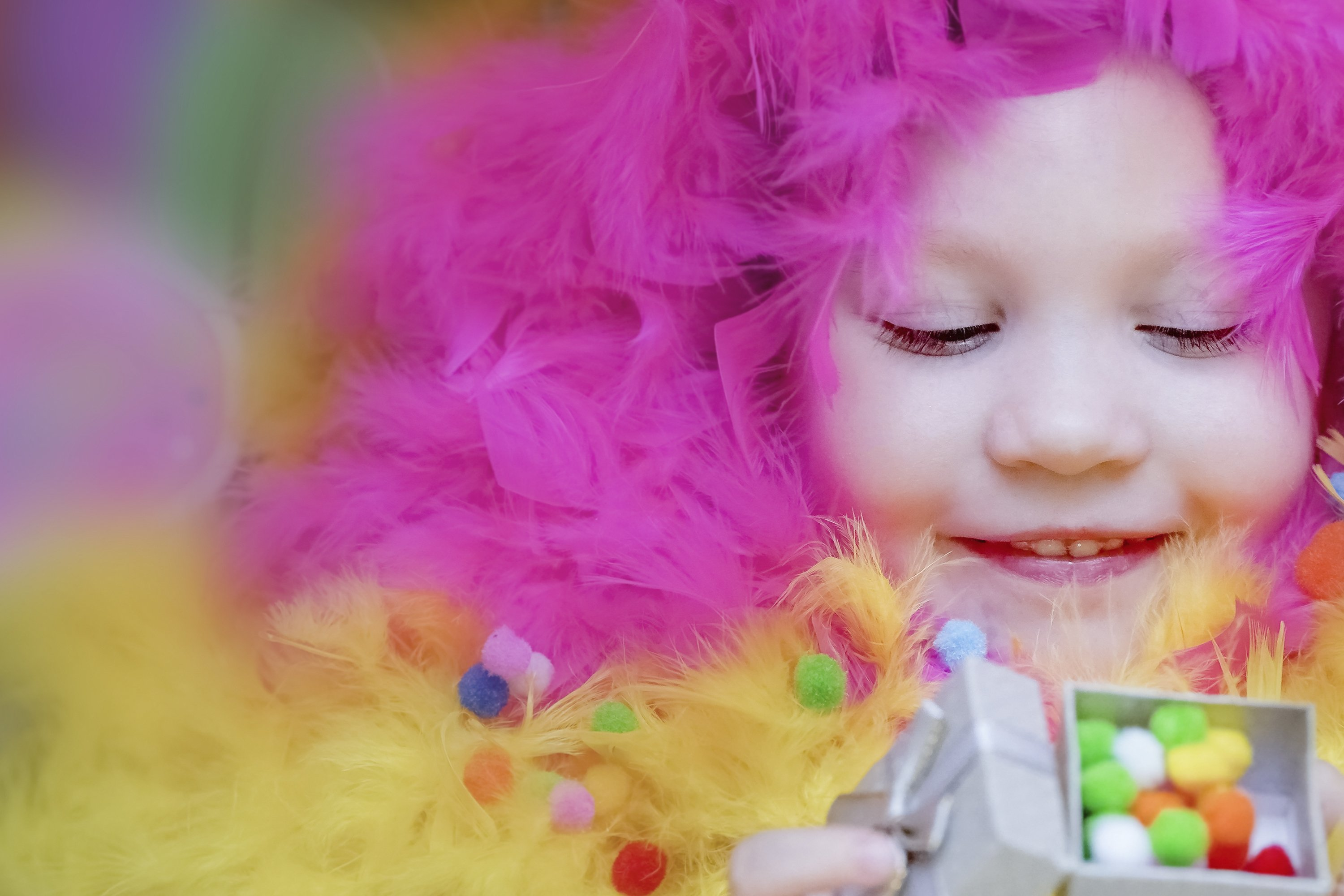 A little girl lies in a blurred festive setting. Birthday example image 1