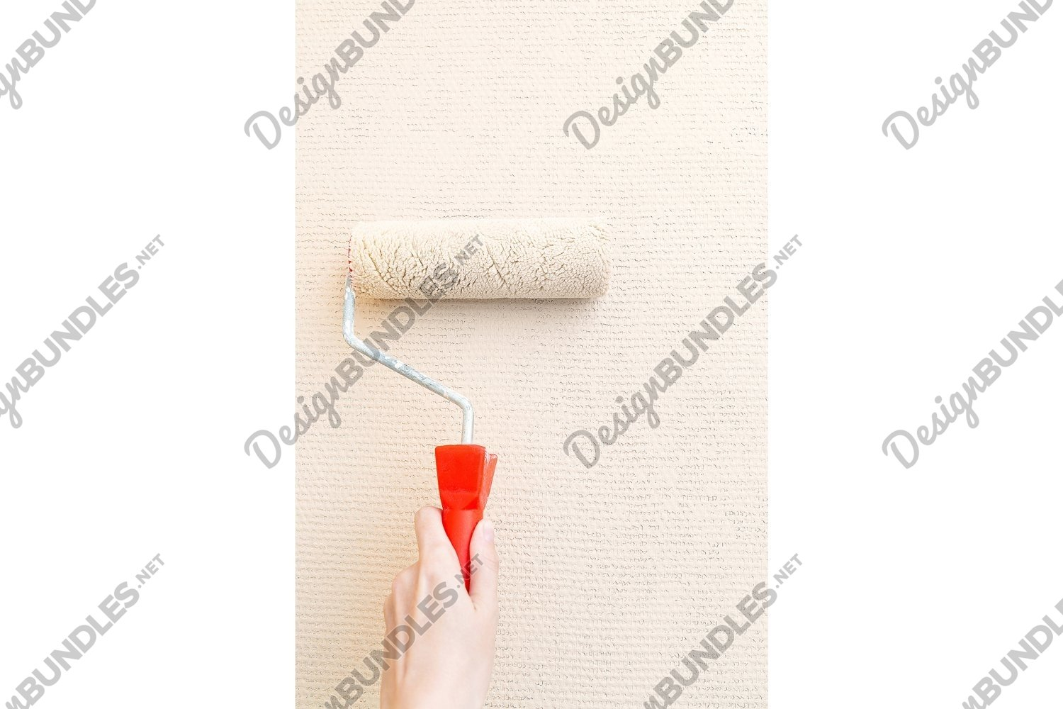 Photo of a hand with a cushion paints the wall example image 1