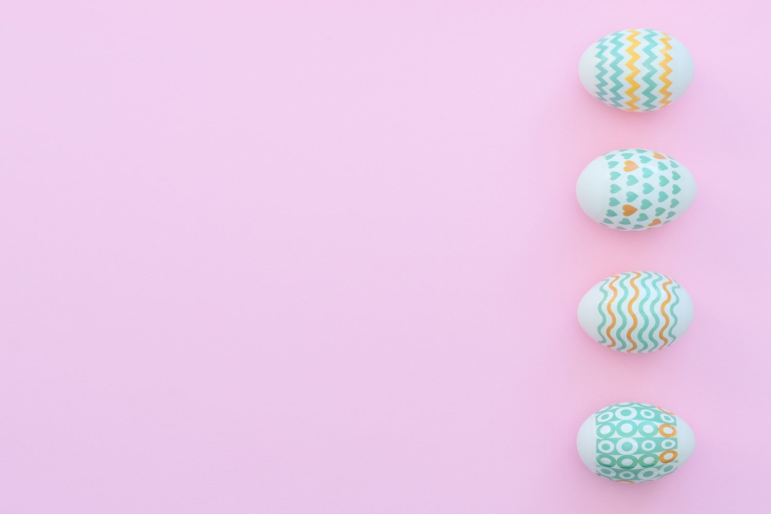 Decorated Easter eggs lie on the pink background. example image 1