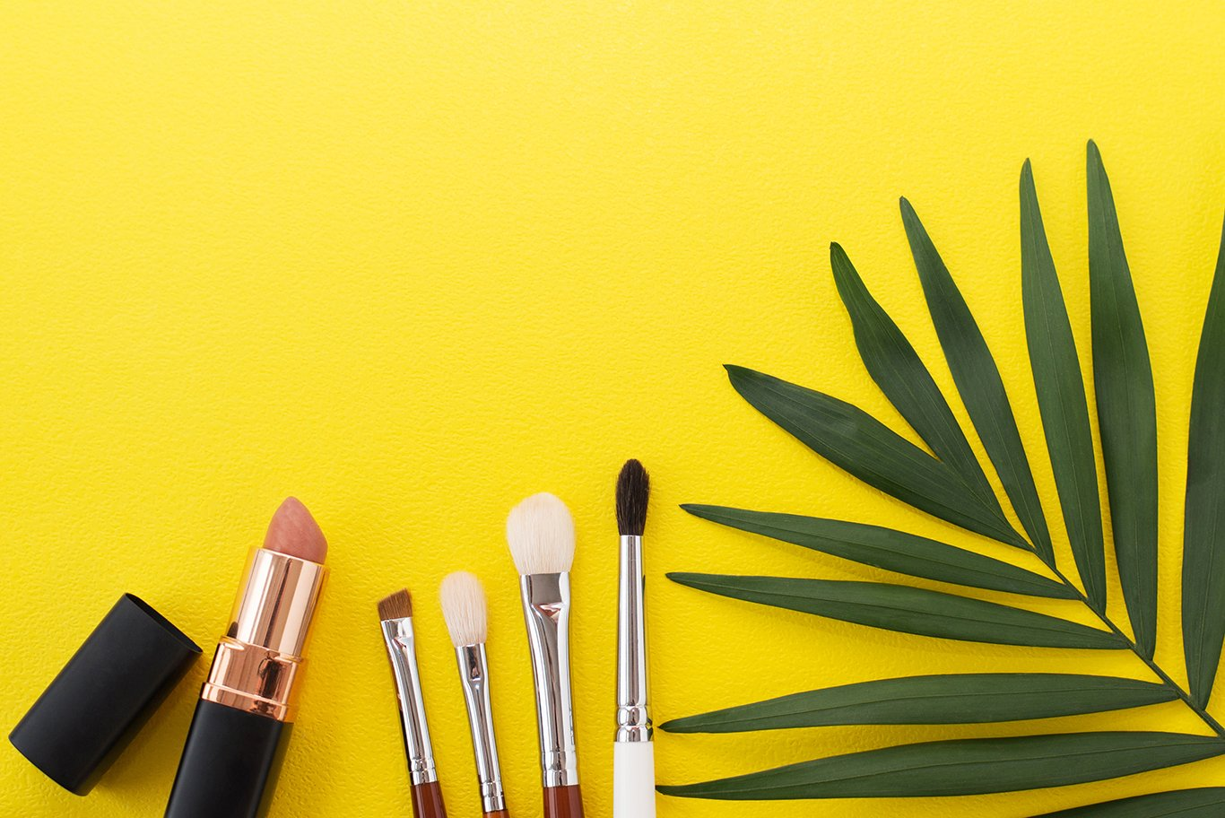 Lipstick with brushes on a yellow background example image 1