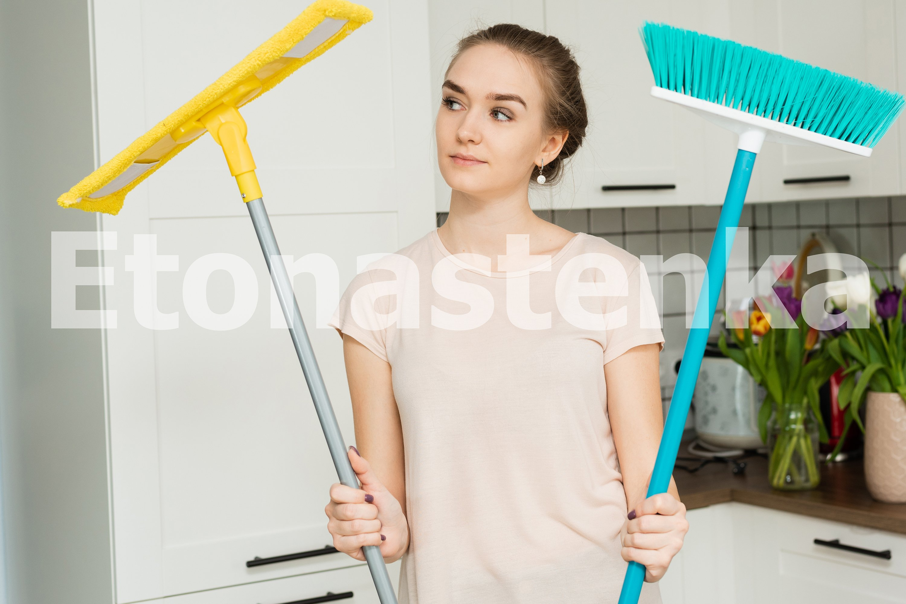 Spring cleaning. A young girl is cleaning her house. example image 4