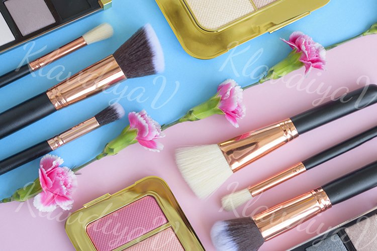 premium makeup brushes and blush on a colored background example image 1