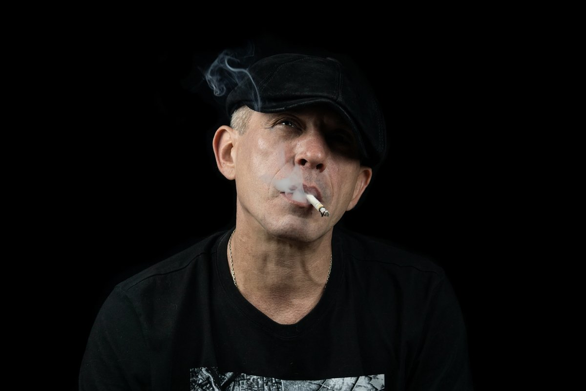 A man with a cigarette example image 1