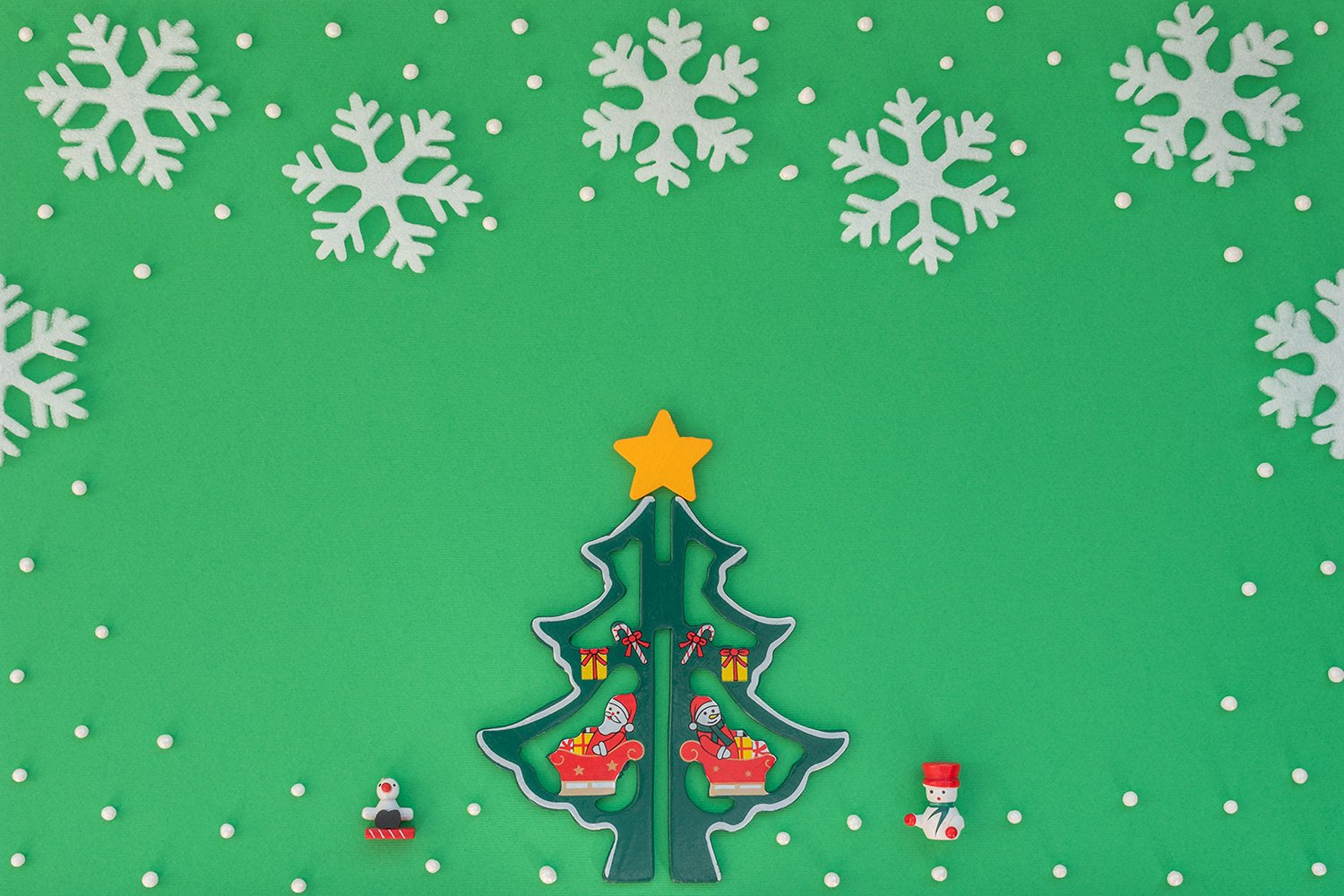 Wooden Christmas tree and white snowflakes example image 1