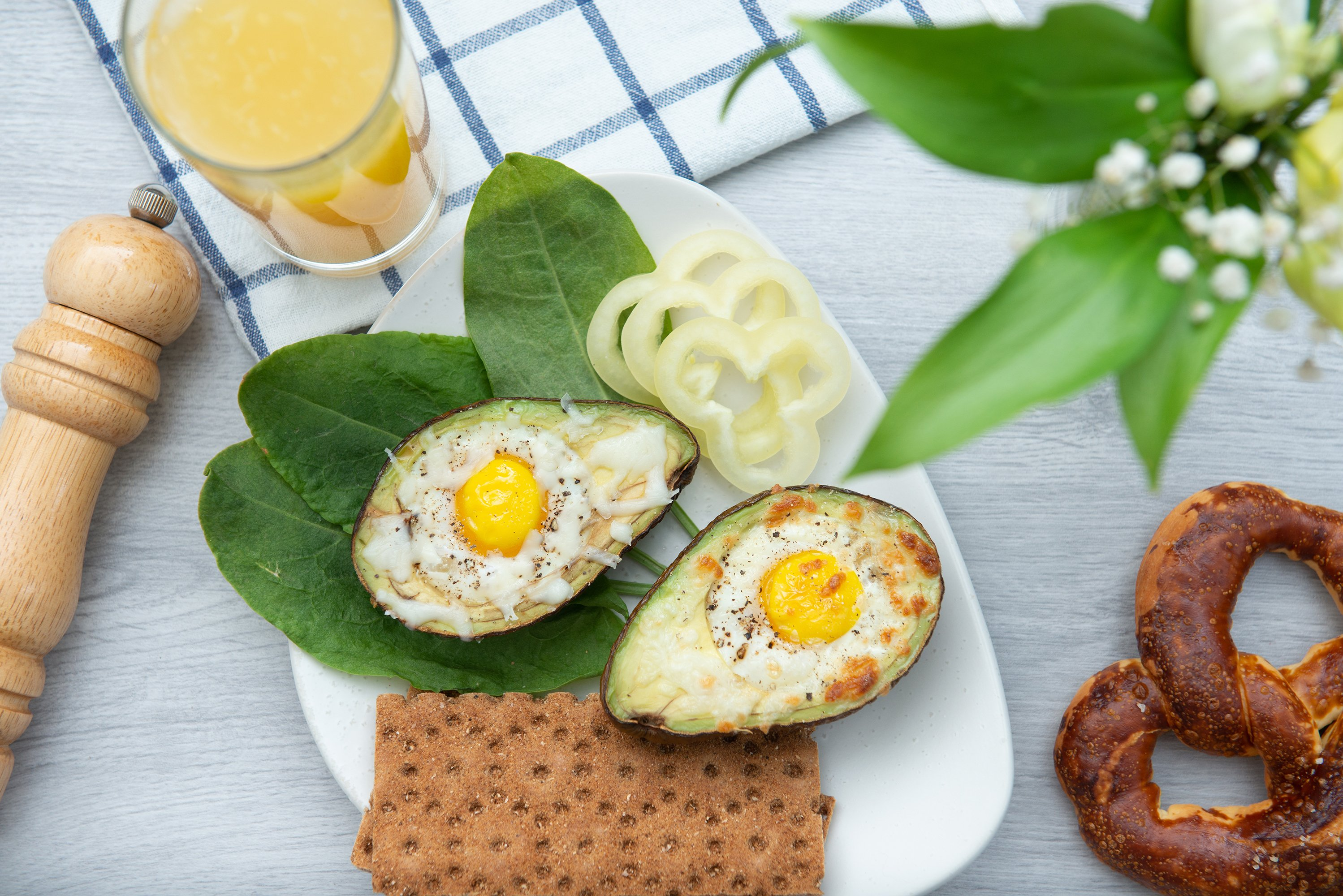 flat lay eggs baked in avocado on plate example image 1