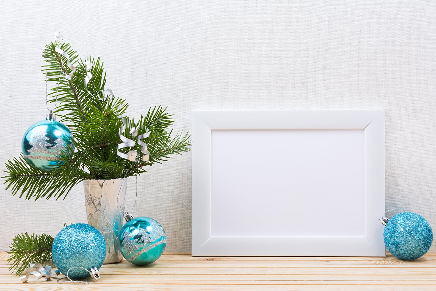 White landscape frame mockup with blue Christmas ornaments example image 2