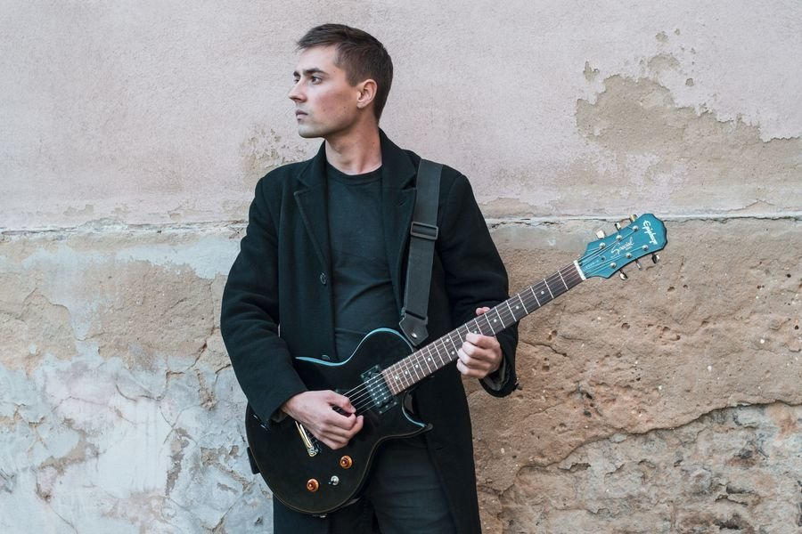Young caucasian man with electric guitar example image 1
