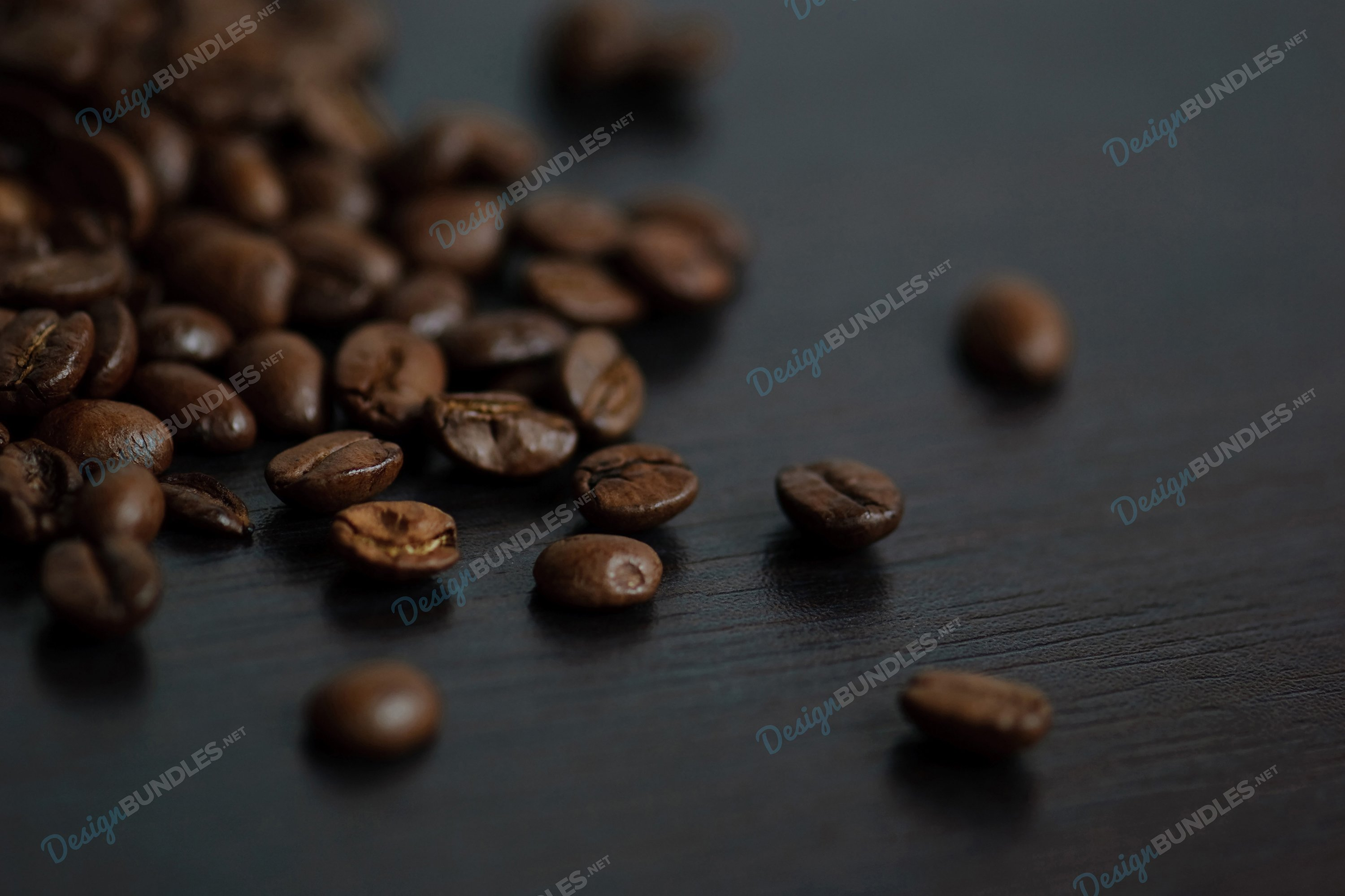 Stock Photo - Roasted coffee beans on a slate plate example image 1