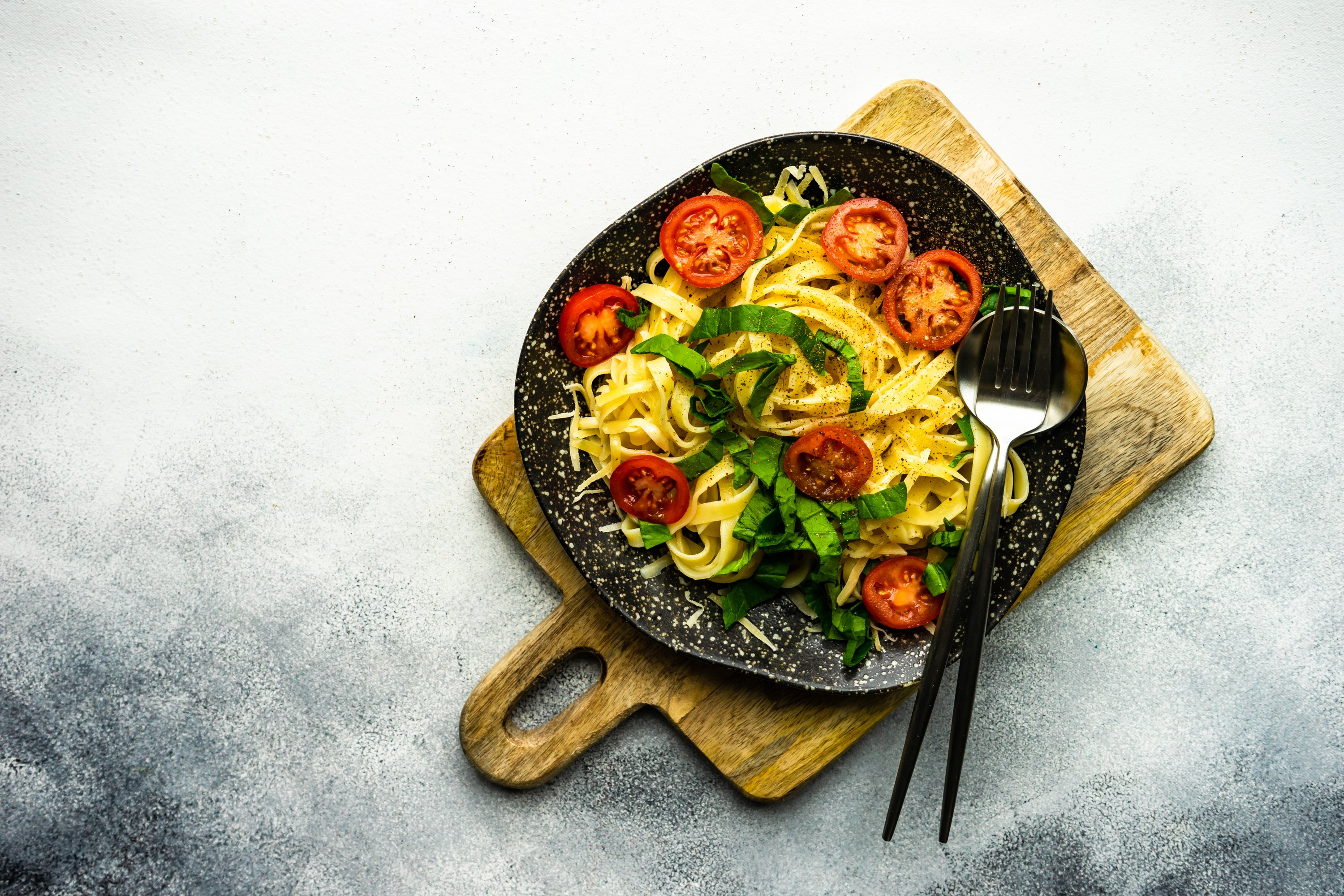 Traditional italian pasta with tomatoes and spinach example image 1