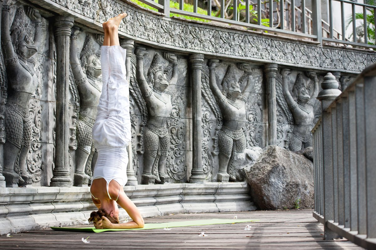 Woman doing yoga in abandoned temple on wooden platform example image 1