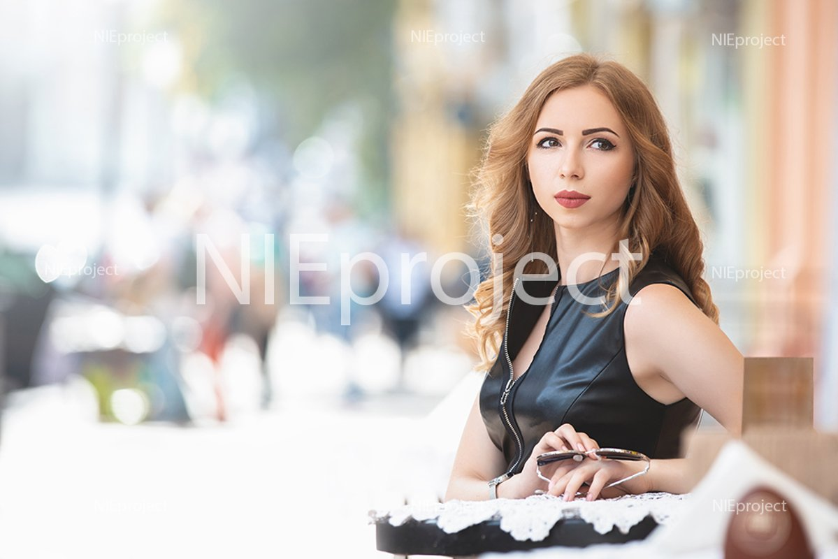 Attractive young Caucasian woman having a rest in cafe example image 1
