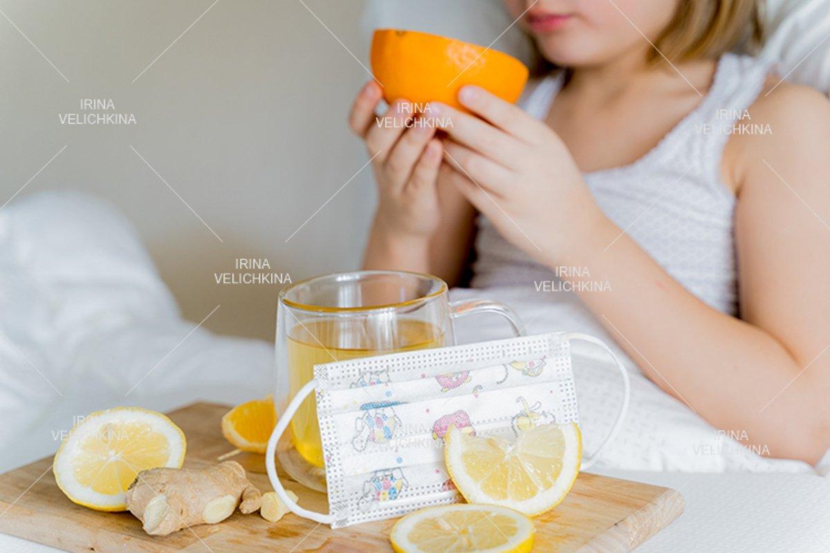 Cup of flu drugs, kids face mask. Tea, orange,lemon,ginger example image 1