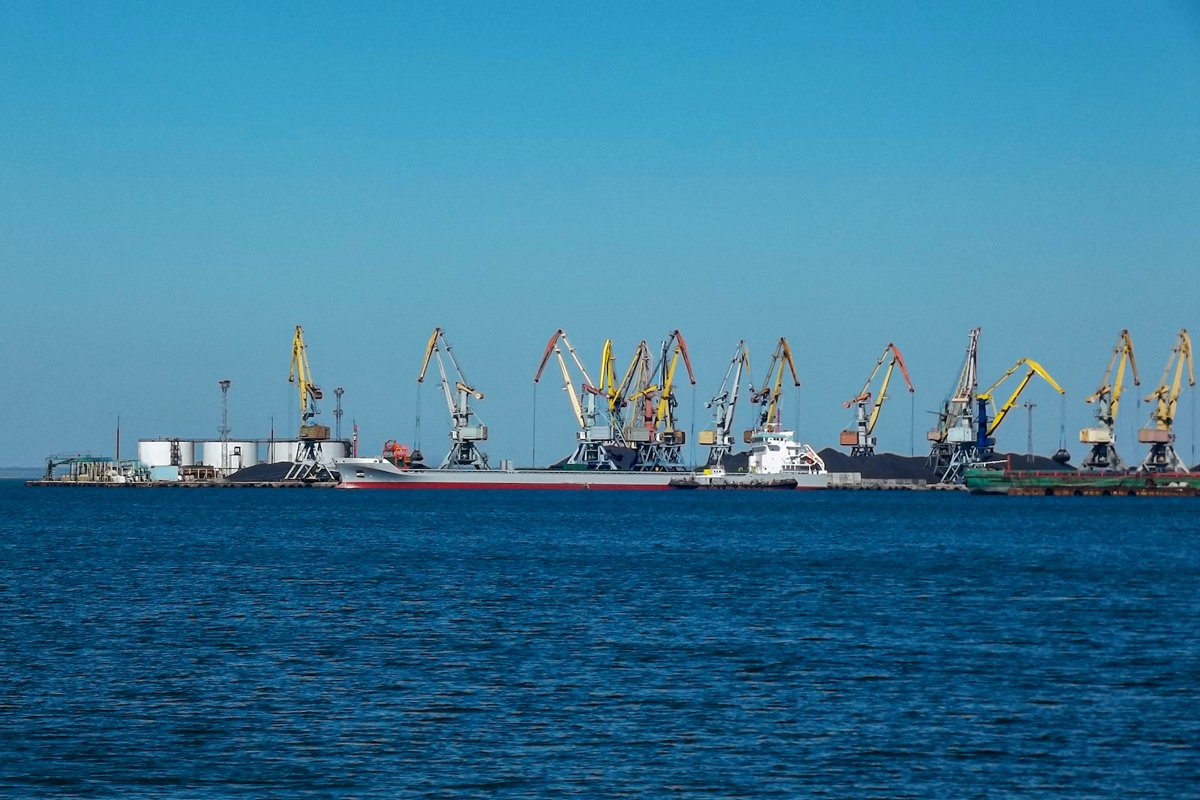Harbor cranes by the sea example image 1