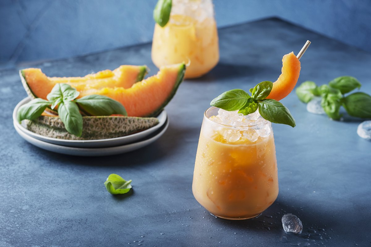 Bar concept. Sweet summer liquor with melon, ice and basil example image 1