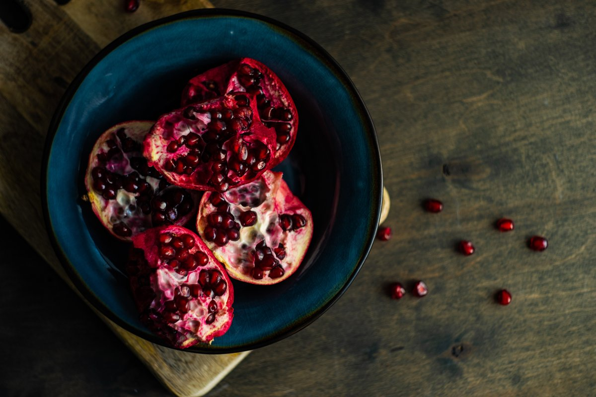 Organic food concept with fresh and ripe pomegranate example image 1