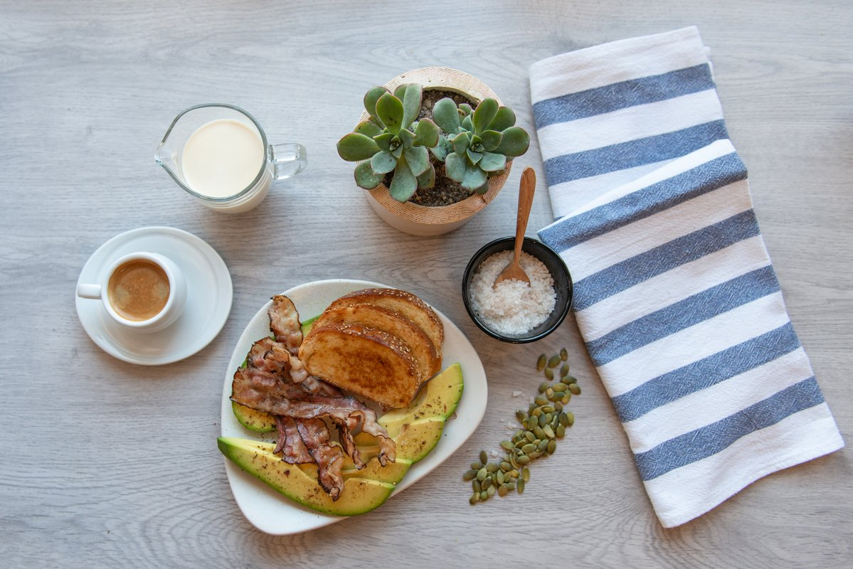 Fried bacon on white plate with cup of coffee and milk jug example image 1