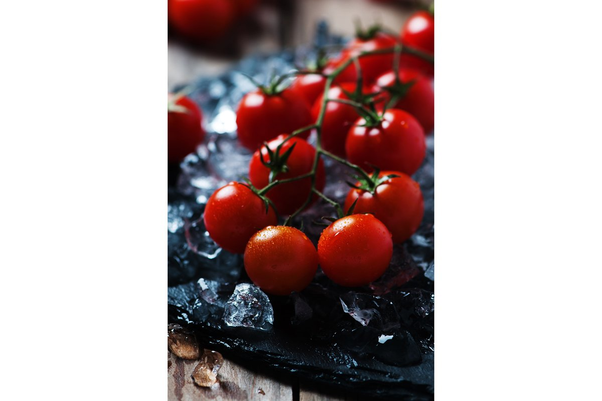 Sweet fresh tomatoes on the wooden table, selective focus example image 1